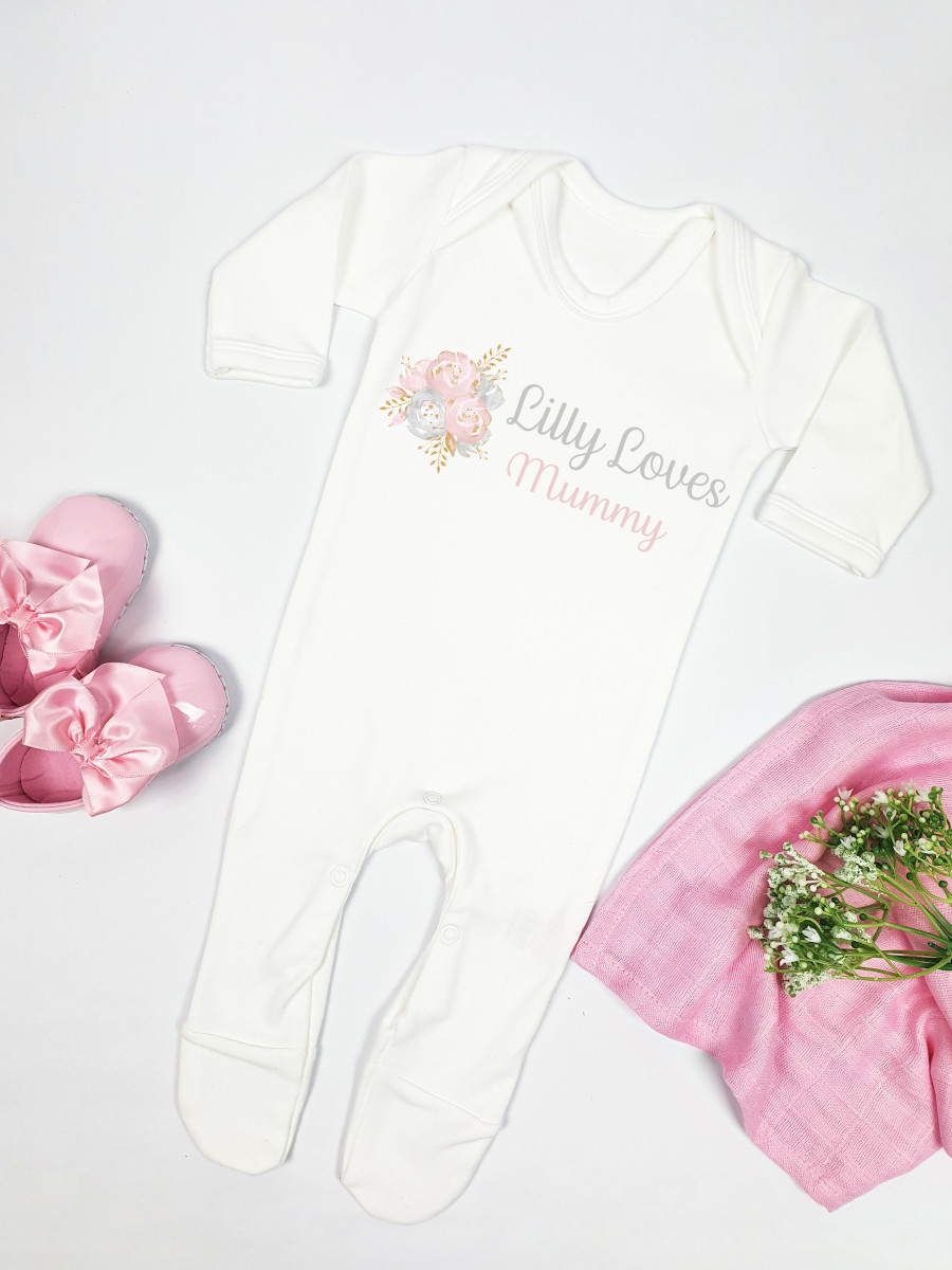 Personalised White Babygrow with Flowers Printed and Lilly Loves Mummy Written next to it